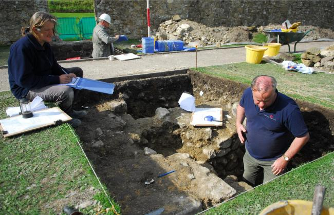 Ten years ago: The walls of a mystery building, more than 800 years old, was discovered in the grounds of Carisbrooke Castle. Pictured are David Fellows, left, Michael Russell and, back, Brian Kerr.