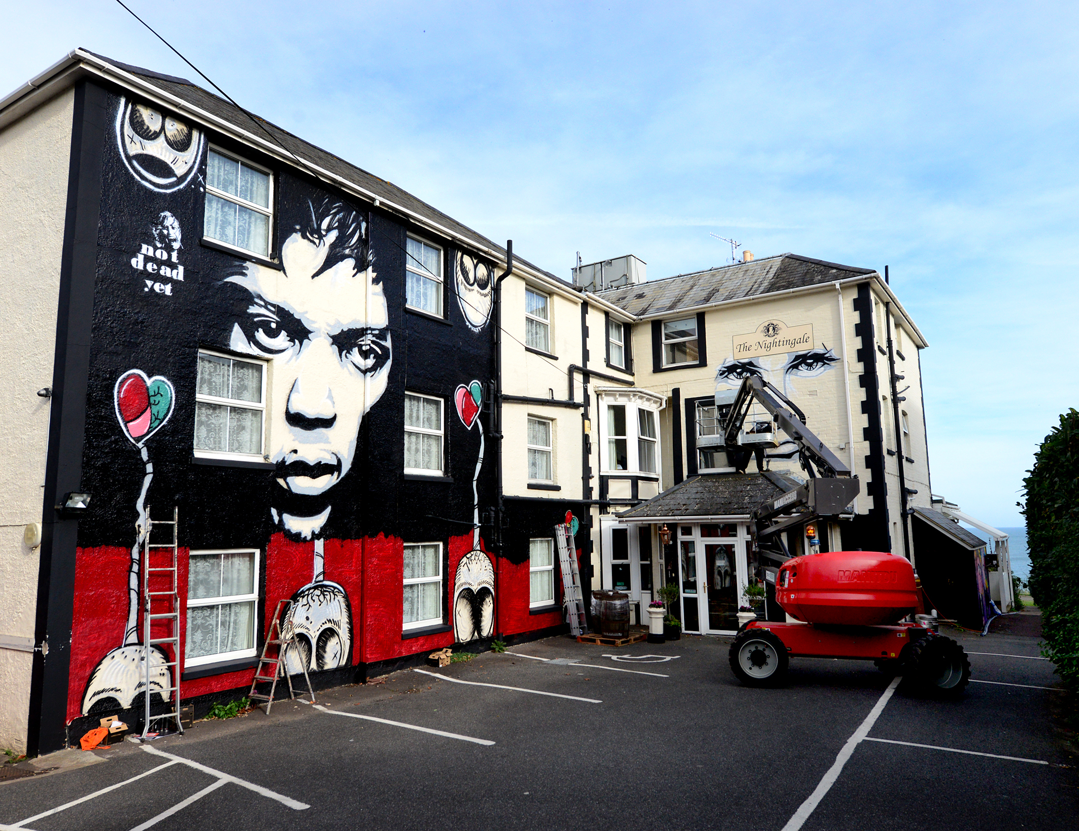 Shanklin - The Nightingale Hotel being spray painted by local artist Tony Trowbridge..