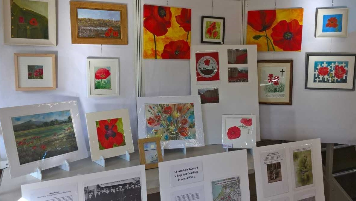 Some of the poppies paintings that will be exhibited at Gurnard Village Hall.