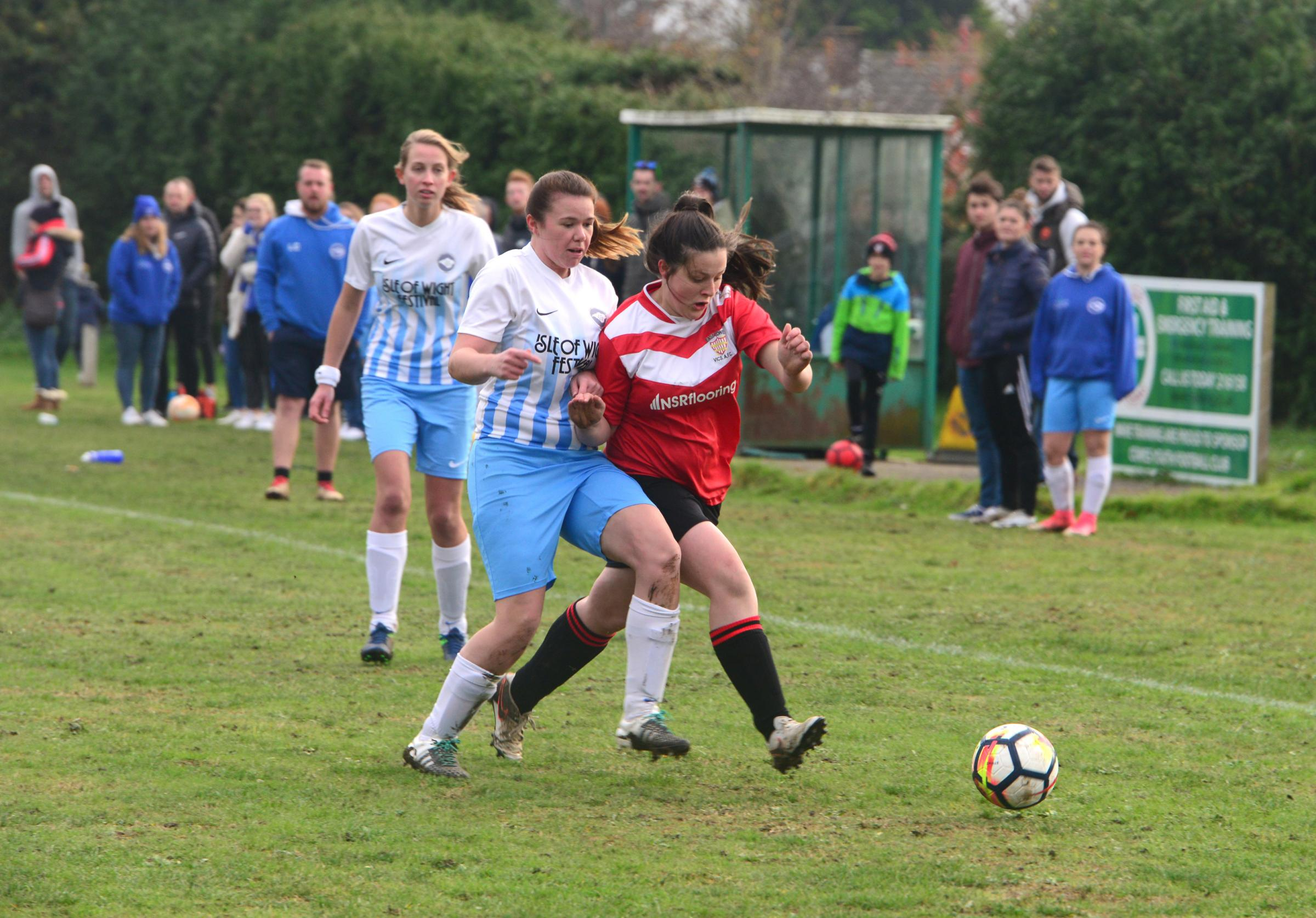 Action between East Cowes Vics Ladies and Cowes Ladies at the Isle of Wight Community Club ground on Sunday.  Photos: Paul Blackley