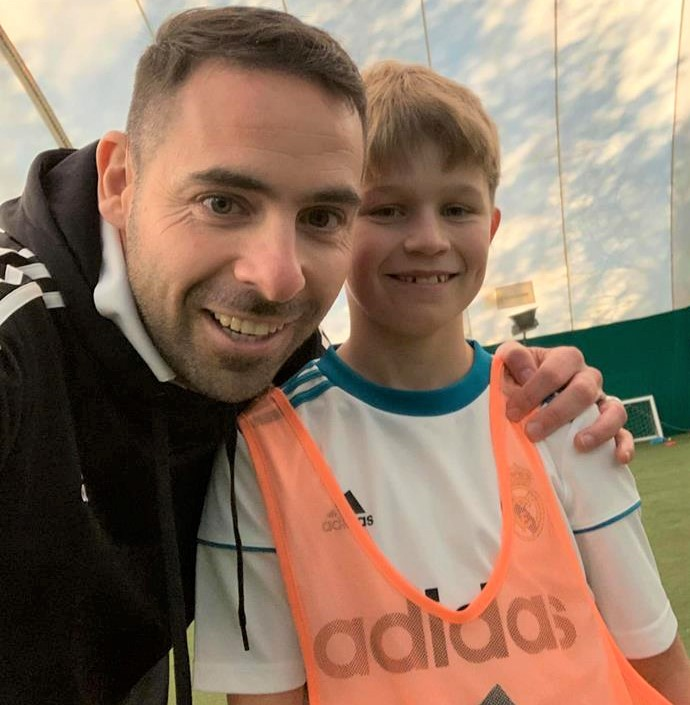 Charlie Hart, 11, of Shalfleet, with Paul Marshall, of Isle of Wight Sports Coaching, was one of five lucky boys selected to train and play at Real Madrid's Bernabeu Stadium next May.