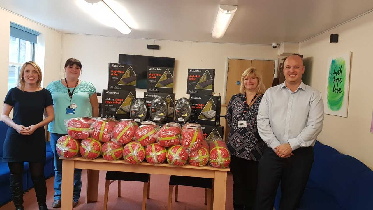 Amey staff delivering sleeping bags at Fellowship House. Left to right: Rachel Lee, Kay Willett and Jan Patterson from the Salvation Army with Amey's Simon Butler.