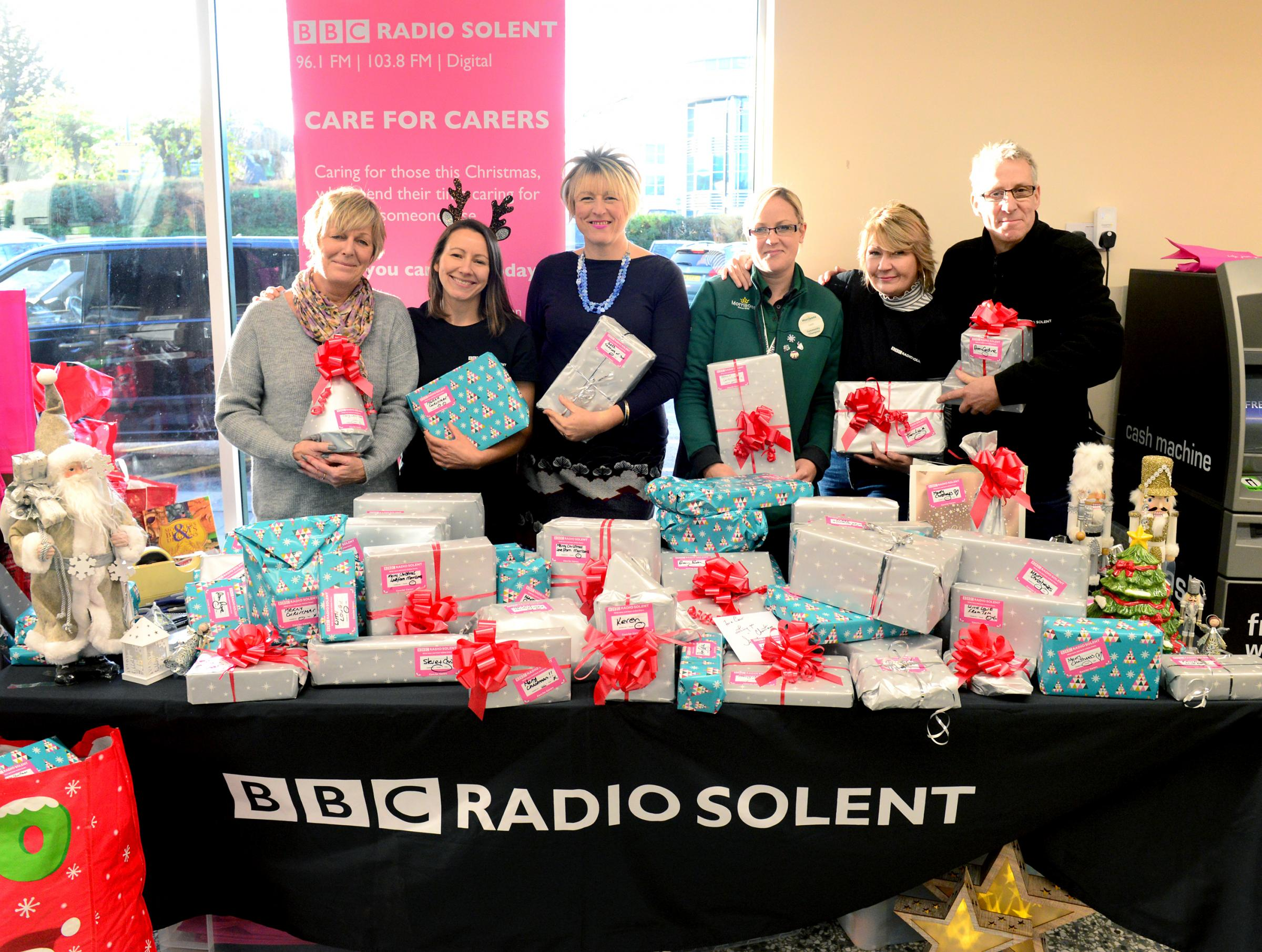 Newport - BBC Radio Solent collecting unwrapped gifts for Christmas at Morrisons. Left, Julie Cocker from Carers IW with Julie Massiter, Rebecca Parker, Morrisons Community Champion Leah Tosdevin, Justine Field and Alun Newman..