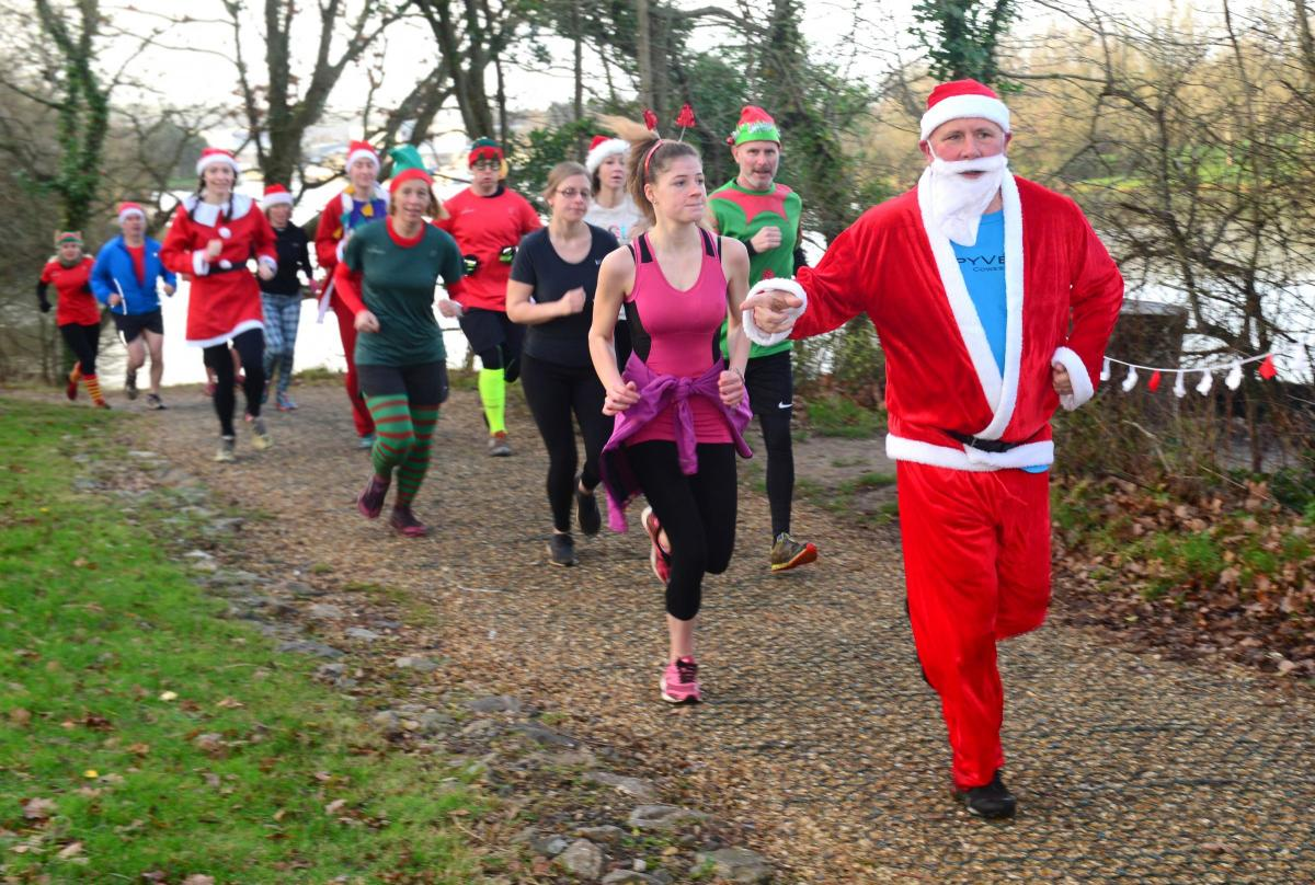 Christmas Parkrun.Festive Runners Take Part In Annual Medina Christmas Parkrun