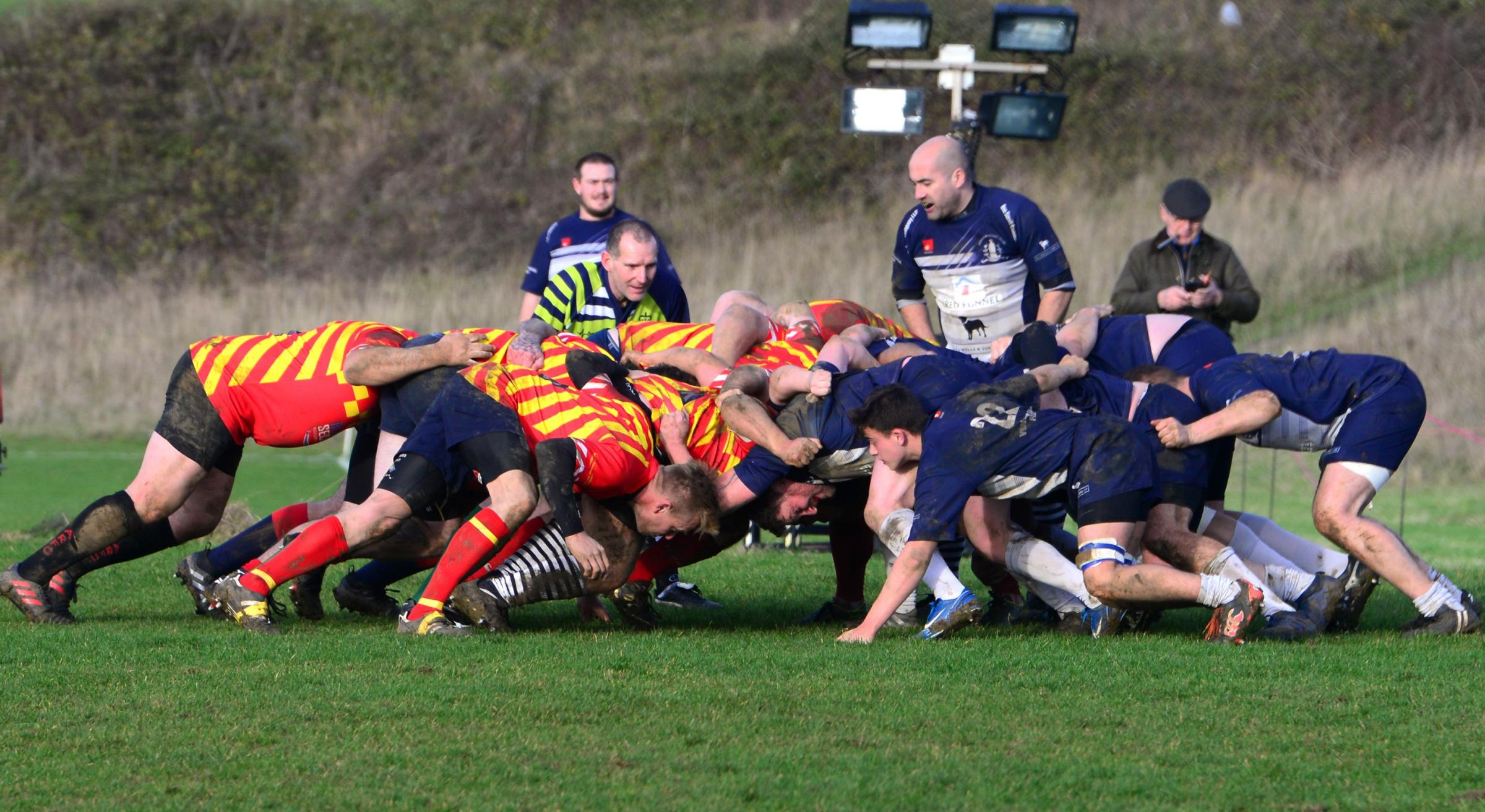 Action between Ventnor (in blue) against an Emergency Services team for the inaugural Martin Poynter Cup clash at Watcombe Bottom yesterday.  Photos: Paul Blackley