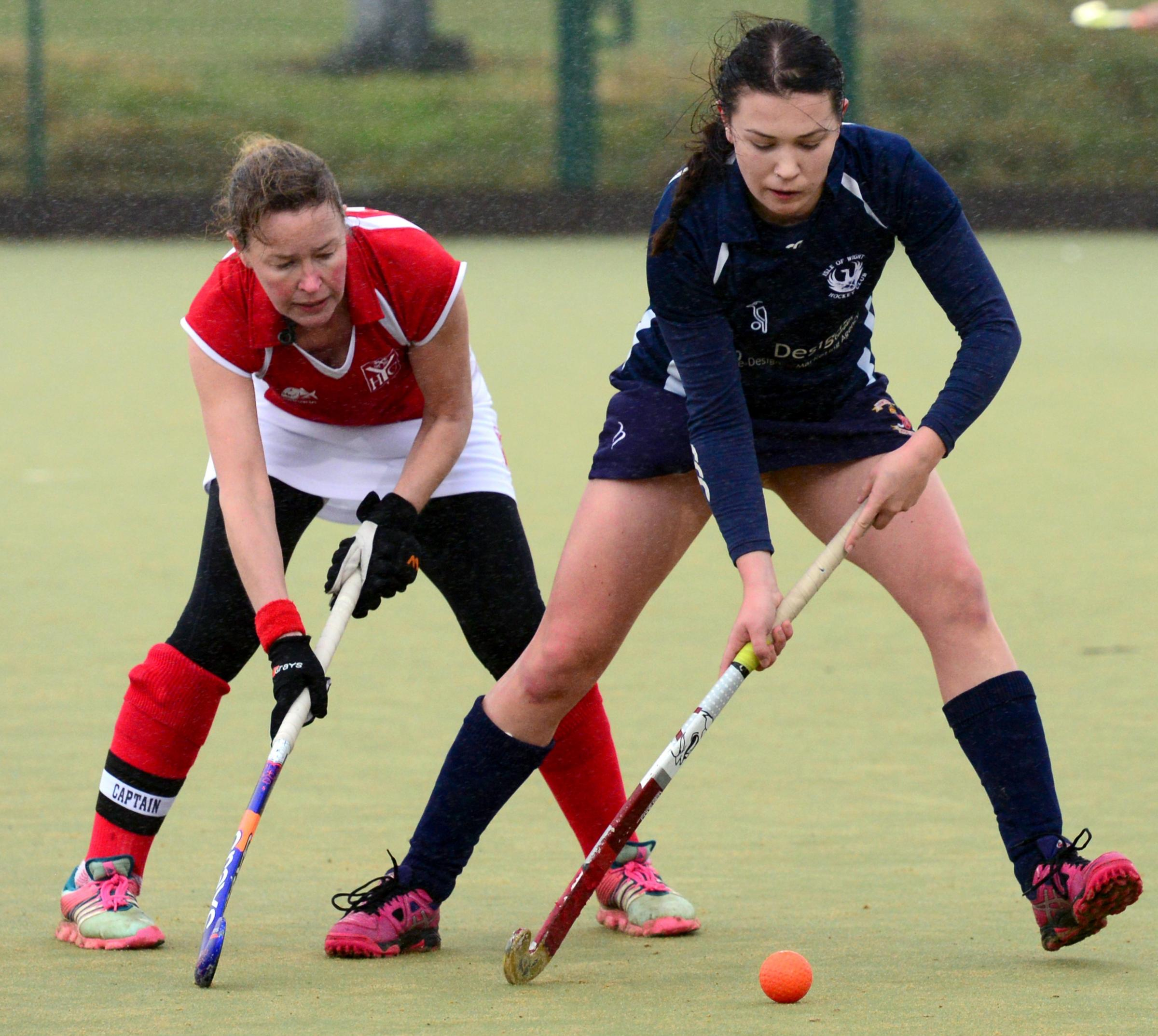 Georgia Whittle (in blue) in action for the Isle of Wight Ladies I against Yateley.  Photos: Robin Crossley