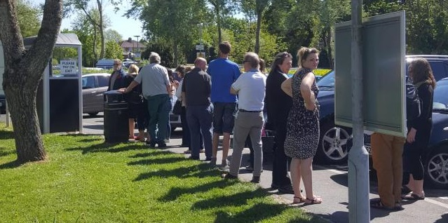 People queuing to pay for parking at St Mary's Hospital.