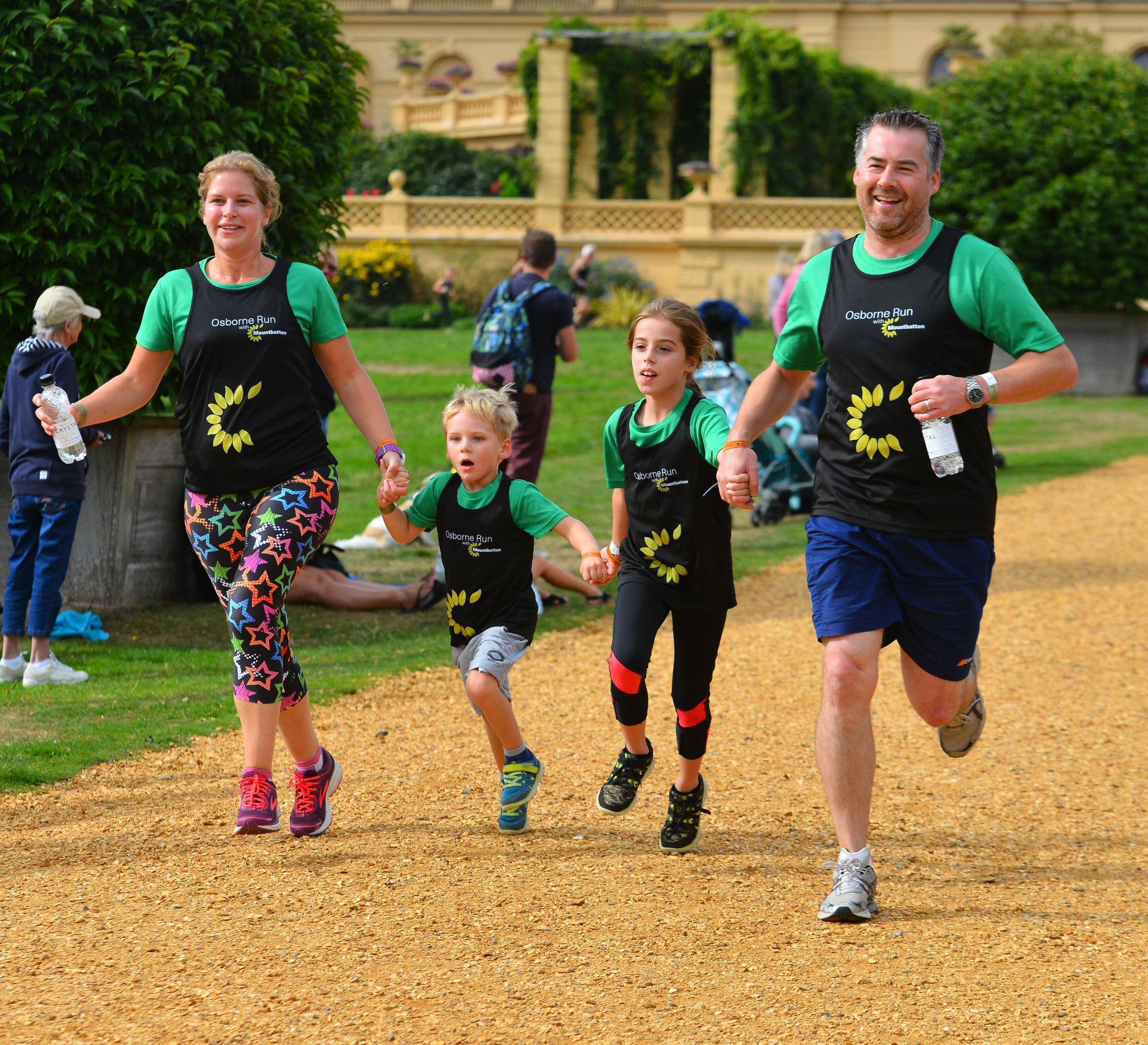 East Cowes - Mounbatten Fun Run at Osborne House. Finish. Left Emily Dodds, Matthew Dodds, four, Lizzie Dodds, and Mike Dodds..