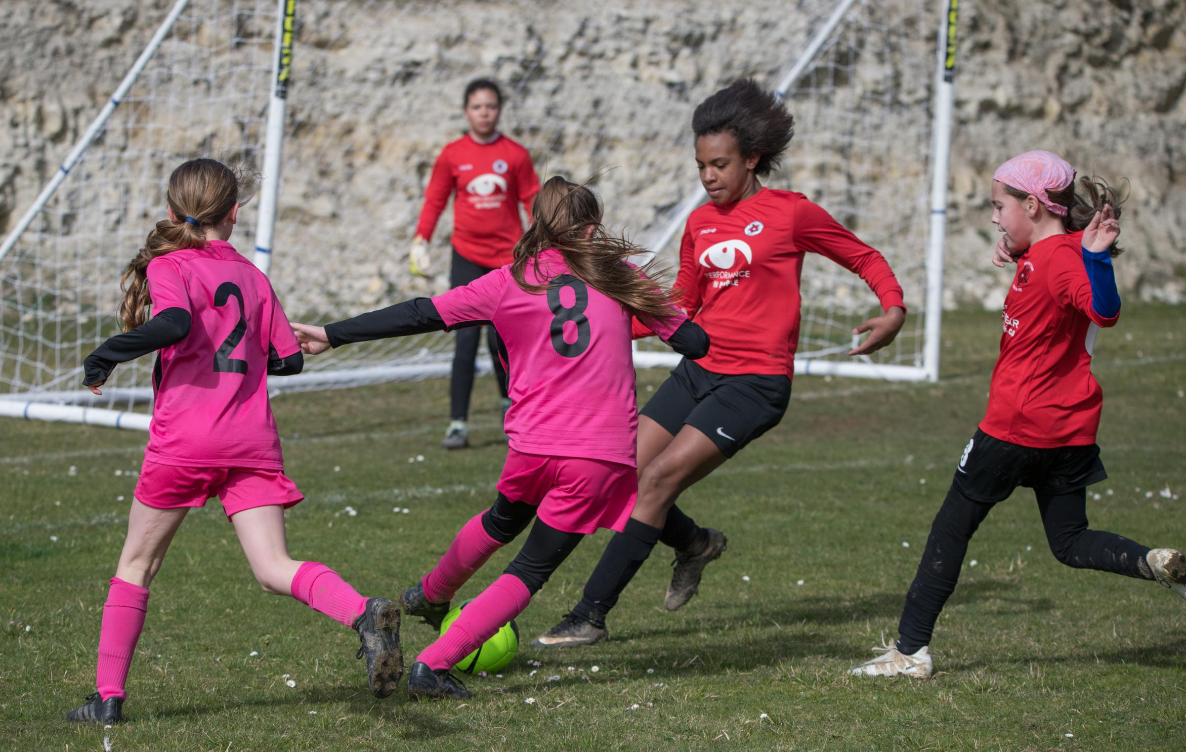 Action between Vectis Youth U13s (wearing pink) and Brading Town.