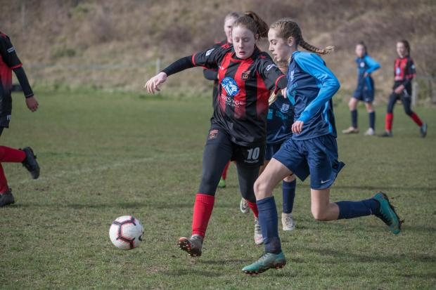 Isle of Wight County Press: Jess Lucas (wearing blue) in action for Rew Valley Girls U14s against Farnham.