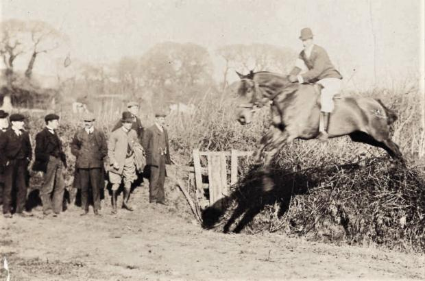 Isle of Wight County Press: Action from the Isle of Wight Hunt Point to Point race at Limerstone in 1907.