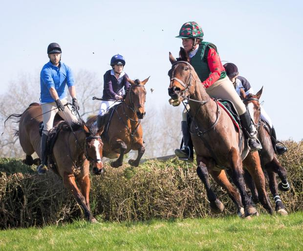 Isle of Wight County Press: Top Isle of Wight eventing rider Karen Begley (red sleeves) in action in the Isle of Wight Grand National. Photo: Jo Monck