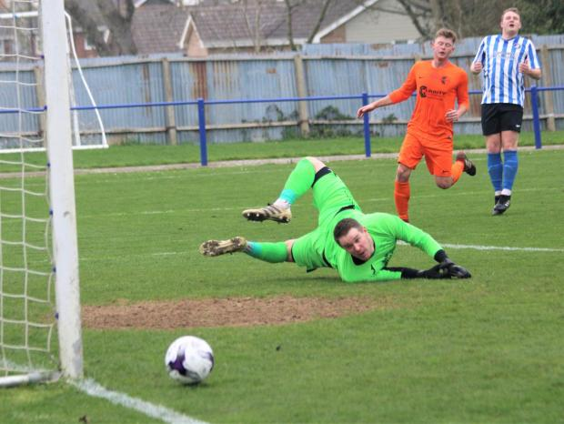Isle of Wight County Press: Jez Conway, in blue, scored twice for Cowes Sports against Portland United. FILE