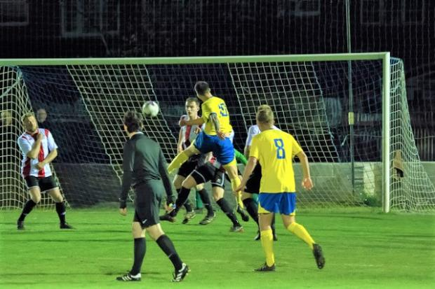 Isle of Wight County Press: Jordan Browne opens the scoring in the seventh minute for Newport against his former club, East Cowes Vics, in the semi-final of the Isle of Wight Senior (Gold) Cup, at Westwood Park, Cowes, on Tuesday night.