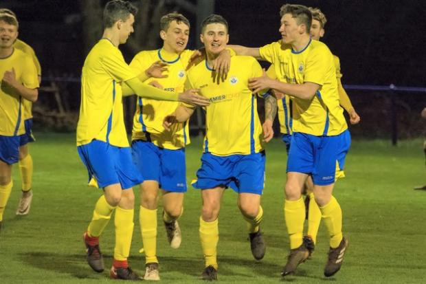 Isle of Wight County Press: Jordan Browne is mobbed by his team-mates after scoring for Newport against Vics.