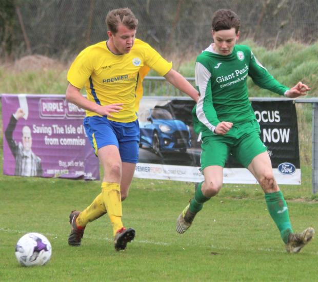 Isle of Wight County Press: Lewis Wright (in yellow) scored twice for Newport against Vics in mid-week. Photo: Simon Dear