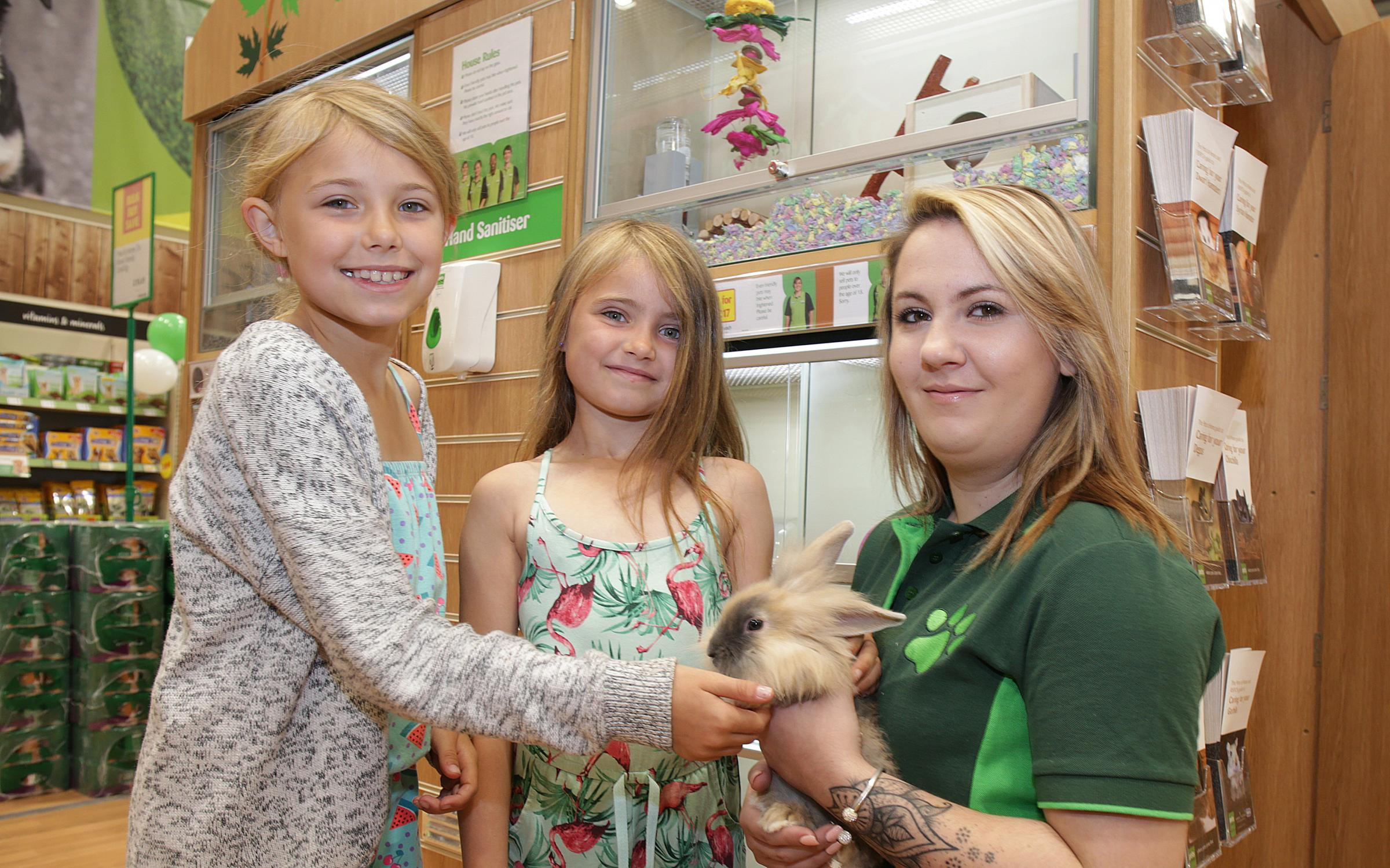 Izabelle and Evie Cassap with Jess Smith. Pets at Home, Waterlooville.