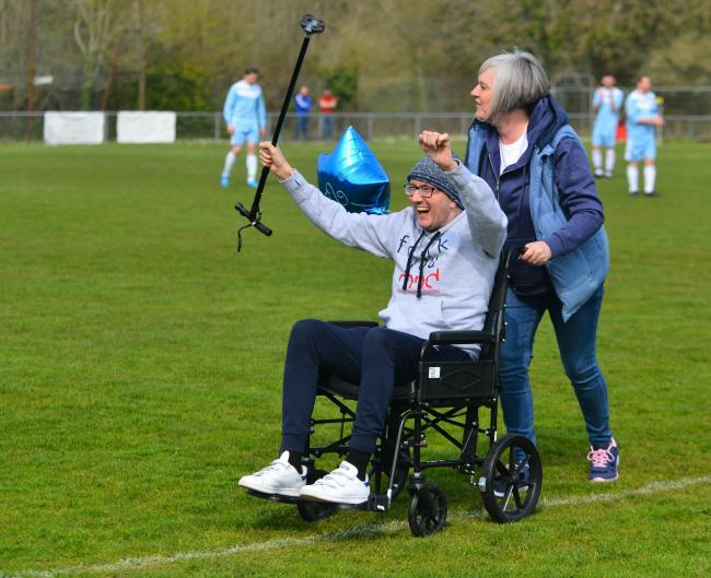 Ben Rothwell cheers with the St George's Park crowd just before the charity match kick-off between HMP IW and the IW NHS Trust.  Photos: Jennifer Thompson