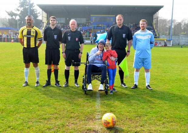 Isle of Wight County Press: Ben Rothwell with his son, Louie, centre, with the team captains and match officials before the charity match kicked off on Sunday afternoon.