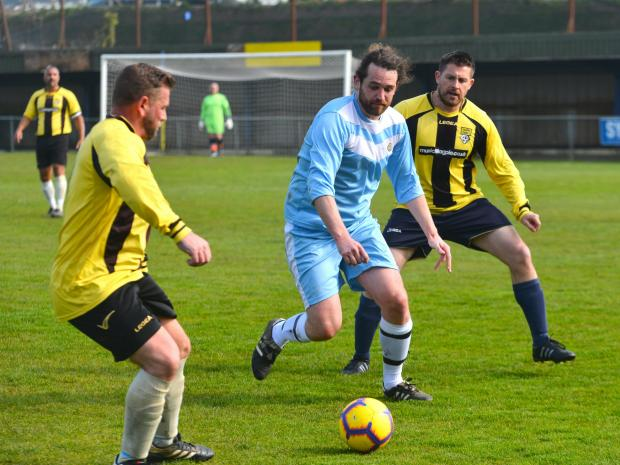 Isle of Wight County Press: Action from the match between HMP IW and the IW NHS Trust, in aid of prison officer Ben Rothwell, who was diagnosed with motor neurone disease.
