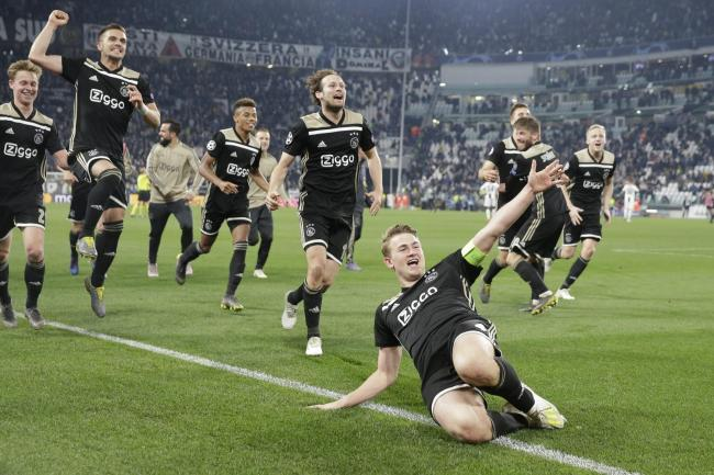 Ajax captain Matthijs de Ligt and teammates celebrate at the end of their Champions League quarter-final victory against Juventus