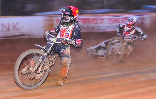 Isle of Wight Wightlink Warriors rider Connor King, left, in action in the semi-finals of the British U21 Championships at Smallbrook Stadium, Ryde, last night (Tuesday).  Photos:  Ian Groves