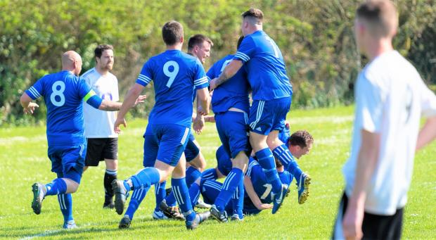 Isle of Wight County Press: Carisbrooke United (in blue) celebrate their second goal in a 5-2 victory over Ryde Saints.