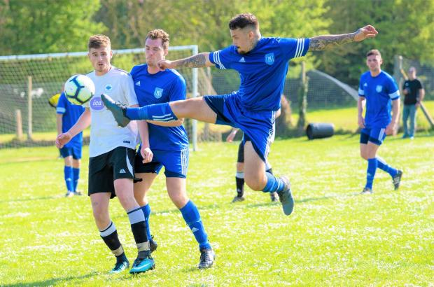 Isle of Wight County Press: Carisbrooke's Jack Manton wins the ball.