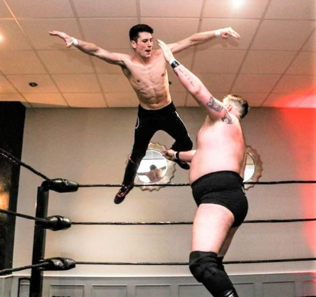 Pro wrestler Matthew Jackson, left, making technical wrestling look easy.