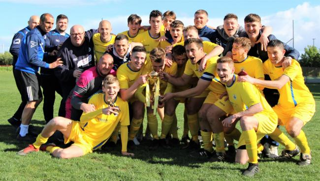 Sydenhams Wessex League Division 1 side Newport celebrate winning the Isle of Wight Senior (Gold) Cup at Beatrice Avenue, East Cowes, this afternoon (Saturday).  Photo: Graham Brown