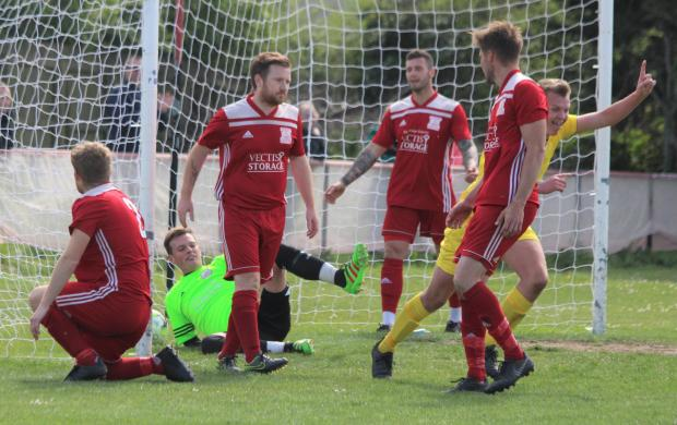 Isle of Wight County Press: Newport's Lewis Wright celebrates scoring his side's fourth ion the first first against W&B. Photo: Graham Brown