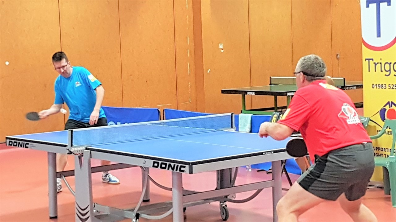Spinalot's Alex Rorke, left, in action against Jim Hall, of Follically Challenged, in the final round of matches in the Isle of Wight Table Tennis Premier League.